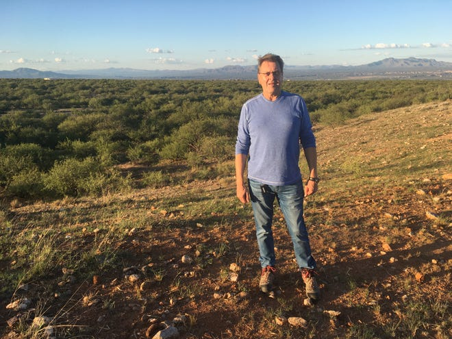 Mike Reinbold, one of the developers with El Dorado Benson LLC, poses for a photo during a visit to the property where the company proposes to build a 28,000-home development called Villages at Vigneto.