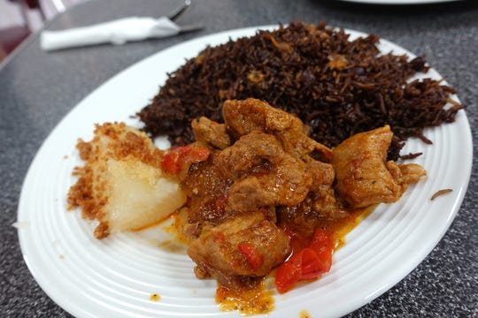 Pollo en salsa with arroz congri and yuca con mojo at Fe La Cubana in Glendale.