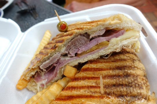 Sandwich Cubano with grilled pork, ham, pickles and Gouda cheese at Fe La Cubana in Glendale.