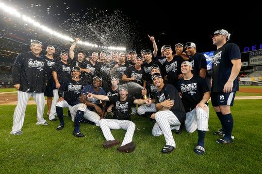 Yankees celebran el título divisional.