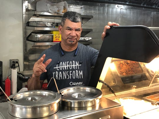 Javi Restaurant owner Juanito Deaza-Santos standing behind the counter at his third eatery and second located in Lebanon.