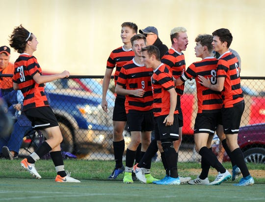 Palmyra celebrates the game's first goal by Joshua Mark (8) during the first half of action.