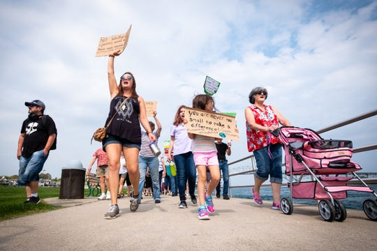 A group of residents from the Blue Water Area march down Thomas Edison Parkway Friday, Sept. 20, 2019, as part of the Global Climate Strike. The march was a way for people concerned about climate change to make their voices heard.