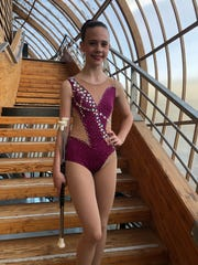 Poughquag's Micah Beaudoin, 11, poses after competing in the International Baton Twirling Federation Grand Prix in France in August.
