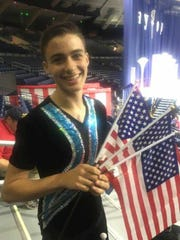 Pawling's Robert Leske, 16, poses after taking first place in three events in the baton twirling national championships at the University of Notre Dame in July.