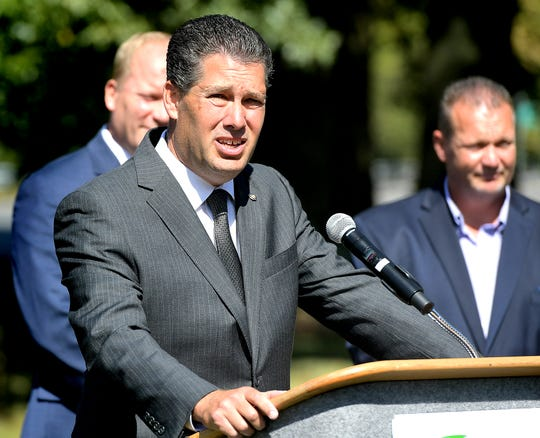 State representative Tom Mehaffie speaks during a Three Mile Island closure event Friday, Sept. 20, 2019. Behind him are Dauphin County Commissioner Mike Pries, left, and Joe Gusler, president of the Central Pa. Building and Construction Trades. TMI began commercial operations in 1974. The event was sponsored by Clean Jobs for Pennsylvania, a coalition formed in support of the state's nuclear power facilities. Bill Kalina photo