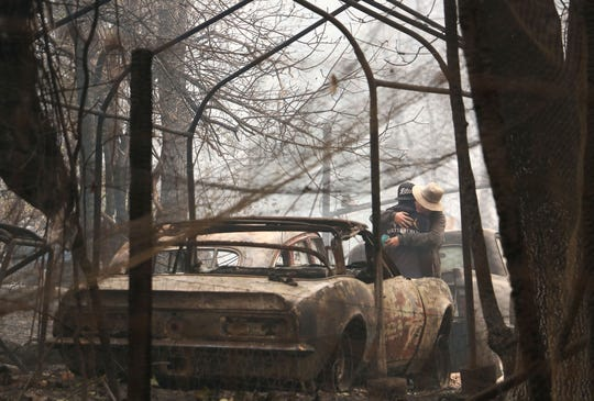 Residents console each other after losing everything in the Camp Fire in Paradise, Calif., on Nov. 10, 2018.
