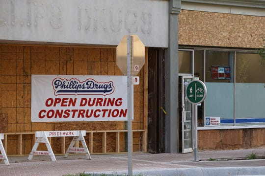 The owner of Phillips Drugs has filed a tort claim notice against the city of Richmond over flooding damage in the building's basement related to the construction of a new bike path along East Main Street.
