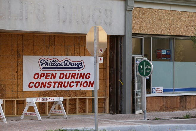 The owner of Phillips Drugs has filed a lawsuit against the city of Richmond, a design firm and a general contractor over flooding damage in the building's basement related to the construction of a new bike path along East Main Street.
