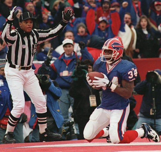 Thurman Thomas rushed for 148 yards and two touchdowns in the Bills' AFC East-clinching victory over Miami on Dec. 17, 1995.