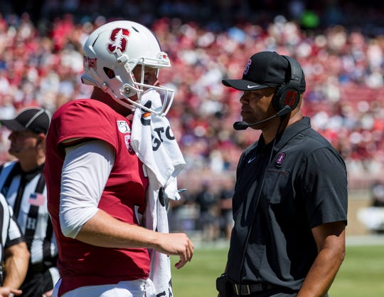 Aug 31, 2019; Stanford, CA, USA; Stanford Cardinal quarterback K.J. Costello (3) and Stanford Cardinal head coach David Shaw during a timor-out in the game against the Northwestern Wildcats in the second quarter at Stanford Stadium. Mandatory Credit: John Hefti-USA TODAY Sports