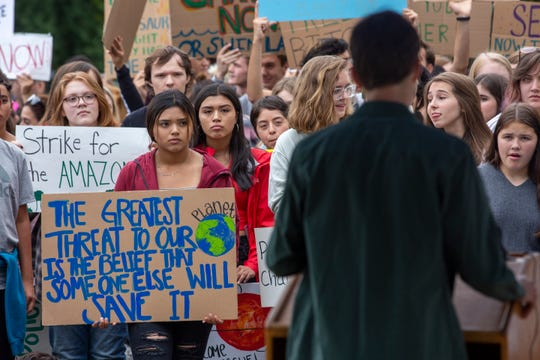 A local student activist speaks to a crowd, urging them to contact local legislatures, during Salem's Global Climate Strike, September 20, 2019, at the Oregon State Capitol in Salem, Oregon. The local strike accompanied others that occurred internationally.