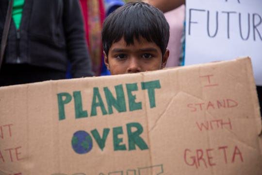 Durgesh Hartley, 4, of Salem joins dozens of younger kids that showed up to protest inaction on climate change at Salem's Global Climate Strike, September 20, 2019, at the Oregon State Capitol in Salem, Oregon. The local strike accompanied others that occurred internationally.