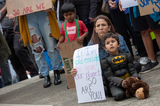 Karen and Matteus Garcia, 5, of Salem, listen to impassioned speeches by local student leaders during Salem's Global Climate Strike, September 20, 2019, at the Oregon State Capitol in Salem, Oregon. The local strike accompanied others that occurred internationally.