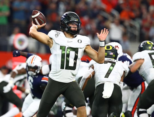 Aug 31, 2019; Arlington, TX, USA; Oregon Ducks quarterback Justin Herbert (10) throws in the pocket in the first quarter against the Auburn Tigers at AT&T Stadium. Mandatory Credit: Matthew Emmons-USA TODAY Sports