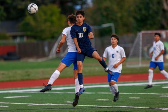Riley Menezes of the Bulldogs and Jayden Esparza collide midair, September 19, 2019, in Stayton, Ore. Stayton hosted three-time defending state champion Woodburn.
