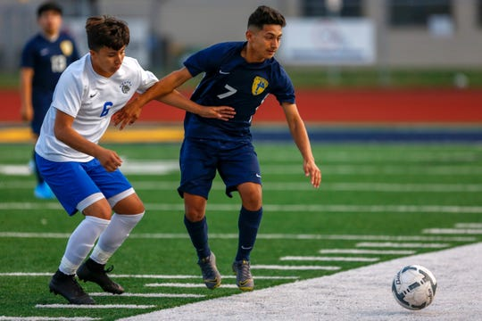 Ricardo Hernandez of the Bulldogs and Isael Ramirez of the Eagles race for the ball, September 19, 2019, in Stayton, Ore. Stayton hosted three-time defending state champion Woodburn.