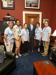 Salem's Teresa Warnock and Kathy Ottele, left and right of U.S. Congressman Kurt Schrader, join American Cancer Society Cancer Action Network volunteers in Washington, D.C. in September 2019 to call on lawmakers to support cancer legislation.