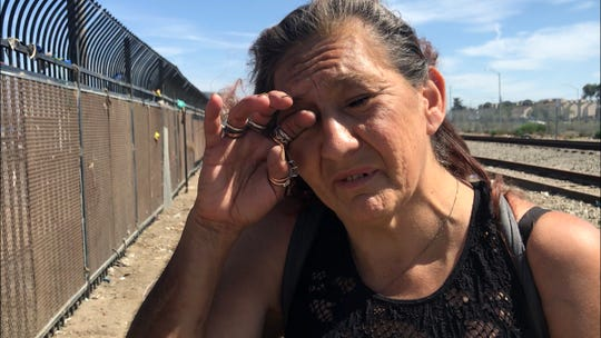 Standing in front of the place her tent once stood, Linda Chavez wipes her eyes. She has glaucoma and needs to take drops daily to deal with the progression of the disease. She is legally blind and lost her medication in the clean-up. Sept. 13, 2019.