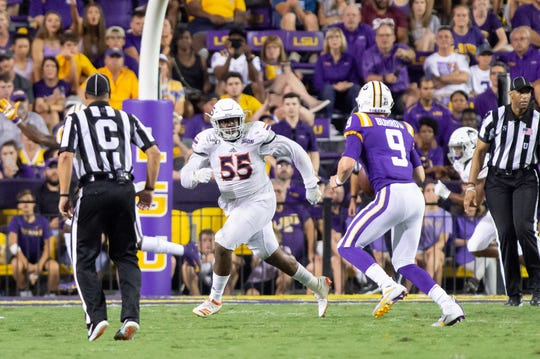 Northwestern State defensive tackle O'Shea Jackson (left) chases LSU quarterback Joe Burrow during Saturday's game at Tiger Stadium. The Demons now head to Houston Baptist to open Southland play.