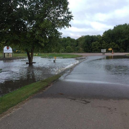 Splitrock Creek spills onto Cherry Rock Gardens on Friday, Sept. 13.