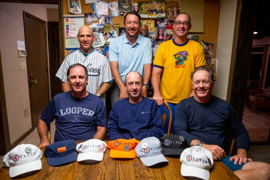 Martin Courtois (front, middle) and his fellow caddies stay at the home of Don Dougherty on Thursday, Sept. 19, 2019. Dougherty died earlier this year, but the caddies, who got to know him last year, have returned to honor his memory and visit with his family.