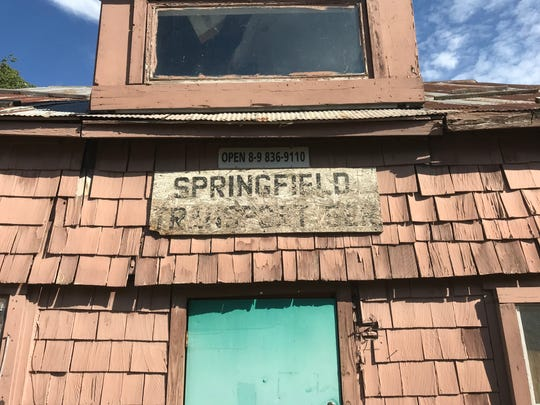 """The sign says """"Springfield Transport Ser."""" The owner of the buildings says he sells about six cars a year and for over 20 years has used the building to store car parts."""