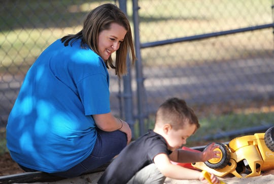 Three-year-olds teacher Kati Fannin watches over Avett Miller on the playground of Faith Preschool, on the corner of John Knox Road and Meridian Road, which celebrated its 60th anniversary over the weekend of Sept. 20-22, 2019.