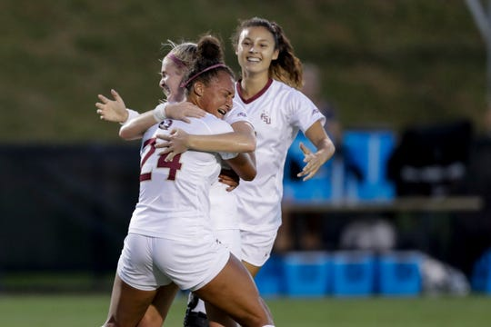 Florida State Seminoles forward Makala Thomas (24) hugs her teammates after scoring a goal during a game between FSU and Boston College at the Seminole Soccer Complex Thursday, Sept. 19, 2019.