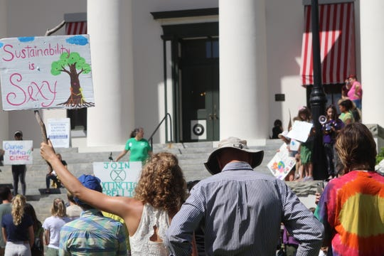 "'Climate Strike' protesters gathered at the steps of Tallahassee's Old Capitol Friday, September 20, 2019 to protest what they called climate change inaction. One woman's sign read, ""Sustainability is sexy."""