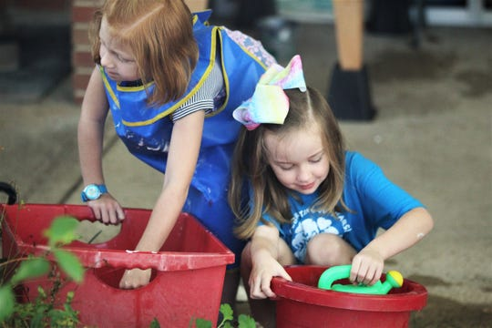 Ava Wise (left) and Greer Nielsen participate in gardening during their 4-year-olds class at Faith Preschool, on the corner of John Knox Road and Meridian Road, which celebrated its 60th anniversary over the weekend of Sept. 20-22, 2019.