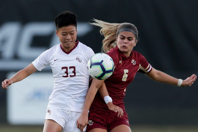 Florida State University Seminoles midfielder Yujie Zhao (33) battles with an opponent during a game between FSU and Boston College at the Seminole Soccer Complex Thursday, Sept. 19, 2019.