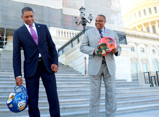 Congressmen Cedric Richmond (left) and Al Lawson are well-respected colleagues. They'll put their friendship aside on Sept. 21 when FAMU and Southern play at Bragg Memorial Stadium.
