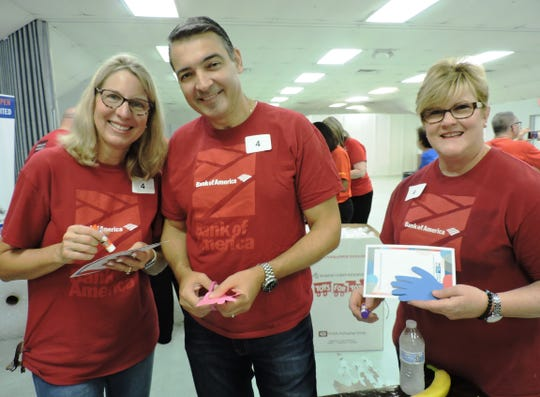 Tammy Matthew, left, Juan Perez and Bonney Johnson of Bank of America at United Way of Martin County's Day of Caring and Sept. 11 Remembrance Ceremony at the Martin County Fairgrounds.