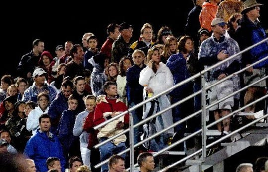 A large turnout of fans stand to watch the start of a Womens Professional Soccer exhibition game between the Chicago Red Stars and Washington Freedom at the Indian River Soccer Association's Hobart Soccer Complex in Vero Beach March 12, 2010.
