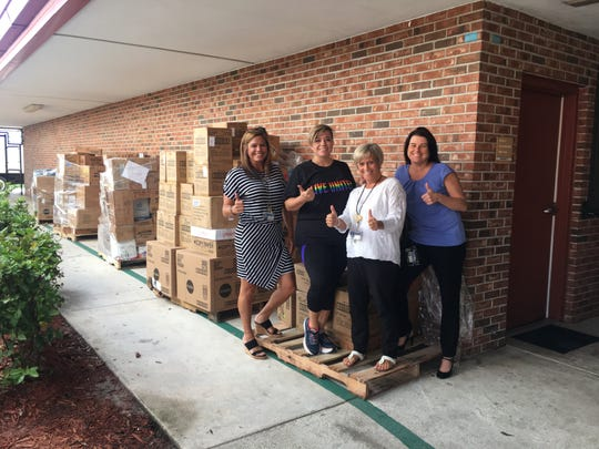 Pinewood Elementary School receives school supplies from Tools for Success. Pictured are, from left, Aimee Morrell, assistant principal; Rachel Terlizzi, United Way of Martin County; Patricia Morris, assistant principal; and Jennifer Radcliffe, principal.