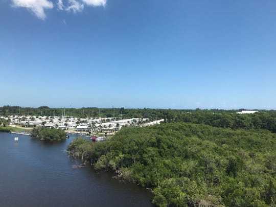 About 16 acres at the foot of the Veterans Memorial Bridge in Martin County, owned by Knight Kiplinger, may be developed into high-end rental apartments. The land sits just north of Riverland modular home development. Tuesday, Sept. 17.