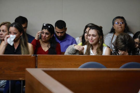 Families and friends of Shannon Del Rio, Joshua and Isaiah Deal, killed in a crash in 2014, weep as they hear testimony about their loved ones at trial hearing on Friday, Sept. 20.