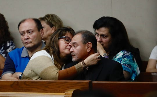 Javier Del Rio, father of Shannon Nicole Del Rio who died in a crash in 2014, is comforted by his wife Laura Del Río after sharing stories about his daughter during a trial hearing in Friday, Sept. 20, 2019.