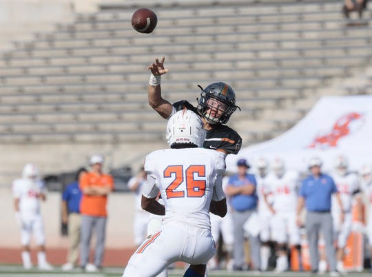 San Angelo Central's Camron Hunter (26) puts the pressure on El Paso Pebble Hills quarterback at the SAC in El Paso, Texas on Friday, September 20, 2019.