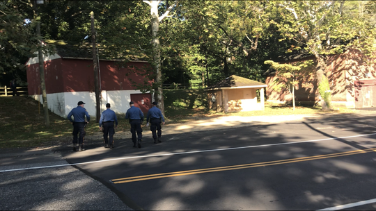New Jersey State Police head to a tree line in Bridgeton's City Park around 9:15 a.m. Friday. At least one helicopter is circling the area where 5-year-old Dulce Maria Alavez was reported missing on Monday.