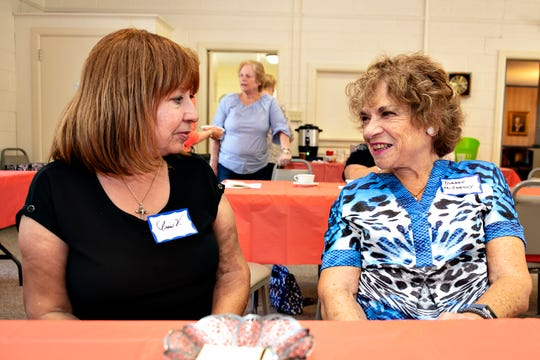 "Iris Violet Figueroa (left), a prospective member of the Millville Woman's Club, chats with Diane McCarthy at the club's ""Meet and Greet"" event for new and prospective members, held recently at the clubhouse in Millville."