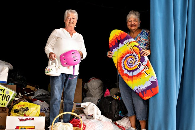 Pat Moore (left), president, Millville Woman's Club, and Donna Pio, club member, display a few unusual items that will be available at the club's annual Rummage, Antique and Collectible Sale.