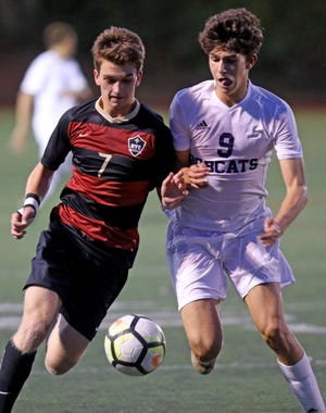 Rye's Michael Traynor (7) and Byram Hills' Nicolas Bisgaier (9) battle for control of the ball during boys soccer game at Rye High School Sept.19, 2019. Byram Hills defeats Rye 1-0.