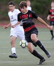 Rye's Connor Camacho (33) pushes the ball up the field past Byram Hills' Bennett Schwartz (15) during boys soccer game at Rye High School Sept.19, 2019. Byram Hills defeats Rye 1-0.