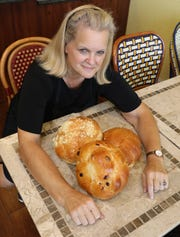 Chanalee Fischer Schlisser, the owner of The Challah Fairy in New City, is pictured with a variety of her challah, including crumb, plain and raisin, Sept. 20, 2019.