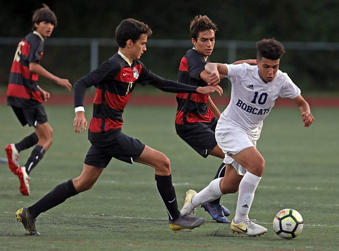 Byram Hills' Yusuf Hafez (10) pushes the ball up the field past the Rye defense during boys soccer game at Rye High School Sept.19, 2019. Byram Hills defeats Rye 1-0.