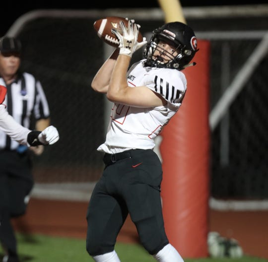Rye's Mark Surhoff catches a TD pass at Somers.