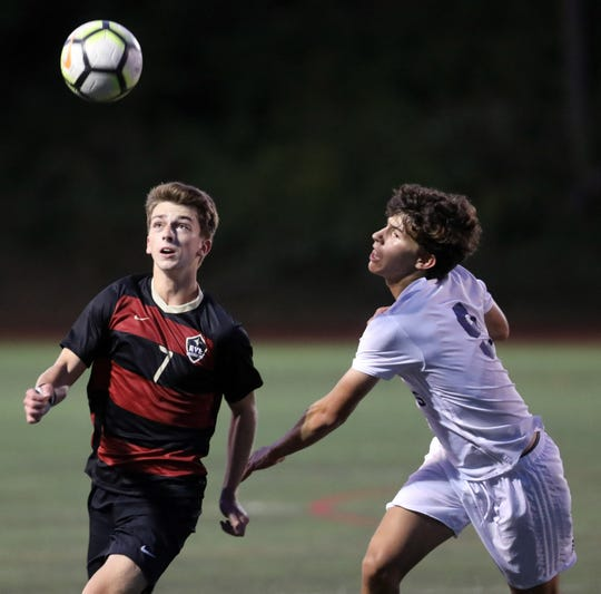 Rye's Michael Traynor (7) and Byram Hills' Nicholas Bisgaier (9) battle for control of the ball during boys soccer game at Rye High School Sept.19, 2019. Byram Hills defeats Rye 1-0.