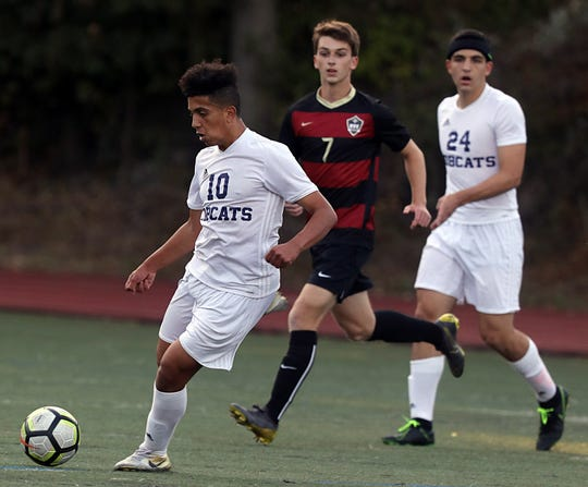 Byram Hills' Yusuf Hafez (10) pushes the ball up the field during boys soccer game at Rye High School Sept.19, 2019. Byram Hills defeats Rye 1-0.